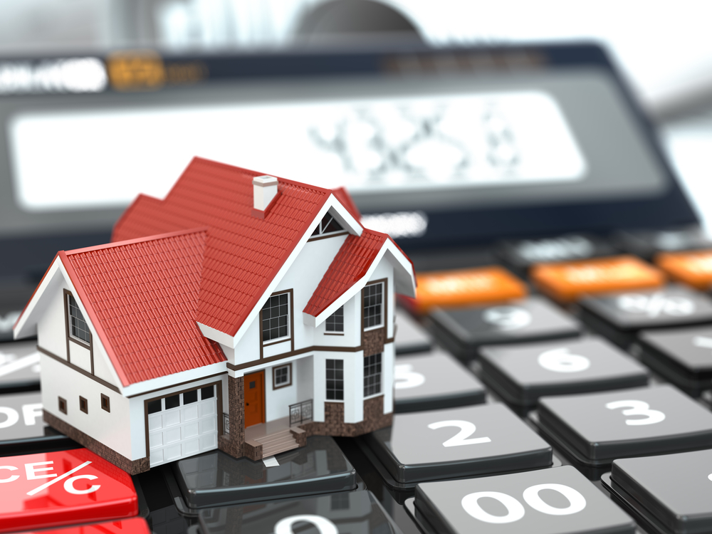 Real estate concept. House on calculator. Mortgage. 3d